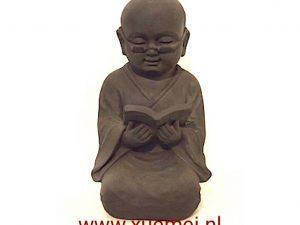 Aardewerk lezende monnik