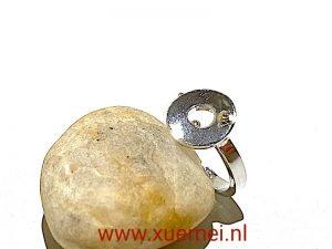 zilveren ring met geluksmunt - edelsmid Xuemei Dijkstal